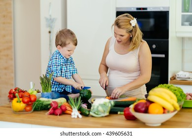 Mother and child preparing lunch from fresh veggies