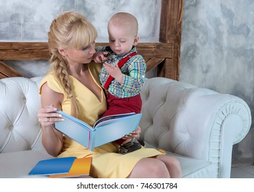 Mother and the child read the book.