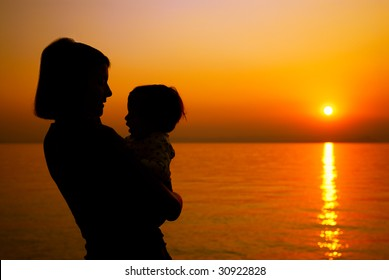 Mother and child silhouette at the sunset