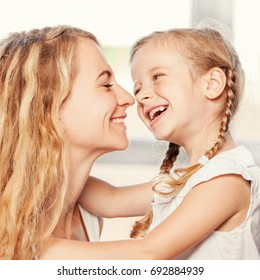Mother with child smiling