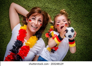 mother child soccer fan