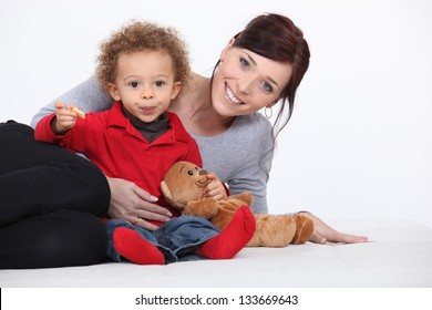 Mother, child and teddy bear