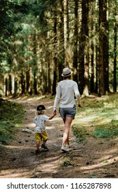 Mother and child walking together in the woods