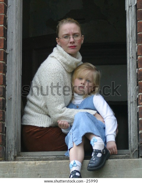 Mother and child in window