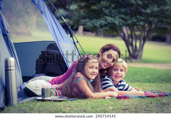 Mother and children camping in the park on a sunny day