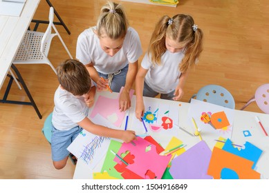 Mother with children. Creative arts and crafts project at school or at home.