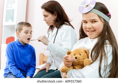 Mother and the children at doctors office