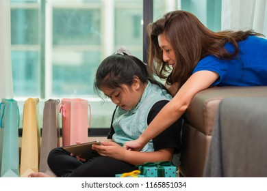 Mother and children doing online shopping.
