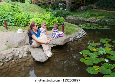 Mother and children enjoy nature, family spring day outdoor