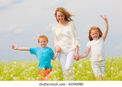 Mother with children Having Fun on field