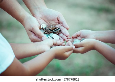 Mother and children holding coin in hands as saving money concept in vintage color tone