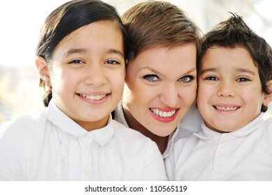 Mother and children at home