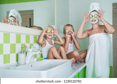 Mother and children make a face mask in the morning.Beauty treatments for the skin