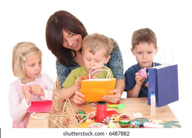 mother and children making Christmas decoration /all decorations are made by mother and children/