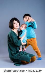 Mother and Children, studio portrait
