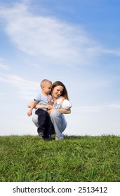 Mother with childrens. Sky. Grass. 3