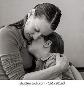 Mother comforting her crying 6 year-old son