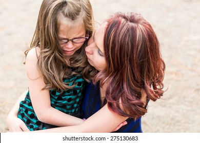 Mother comforting her daughter after getting hurt at a park in Reno, Nevada, USA.