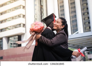 Mother congratulate her daughter, who finish their studies at the university ceremony