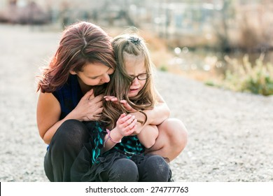 Mother consoling her hurt daughter at a park in Reno, Nevada, USA.