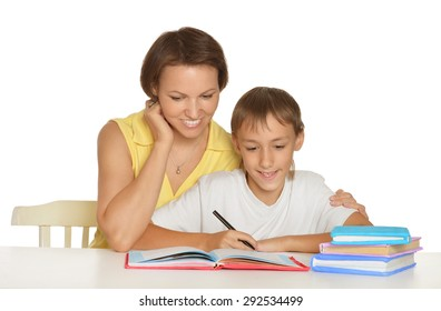 Mother and cute son doing homework together
