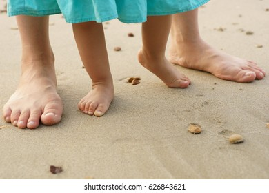 Mother and daugher playing on beach
