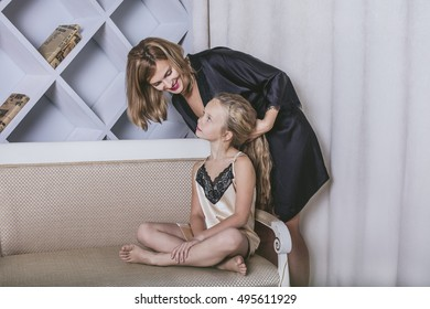 Mother and daughter alone at home beautiful, fashionable and fun. Happy loving family together to spend time relaxing.