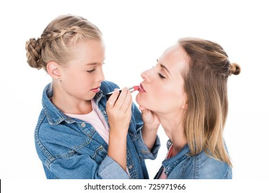 mother and daughter applying makeup together, isolated on white