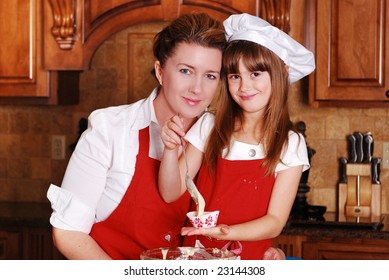 A mother and daughter baking cupcakes together