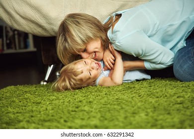 mother and daughter. child and mom playing at home. motherhood