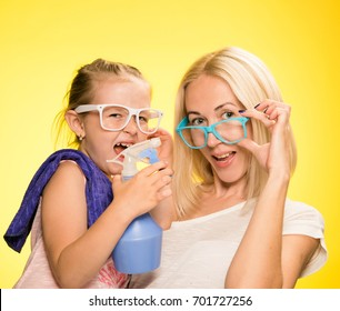 mother and daughter clean the house