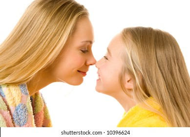 Mother and daughter close-up portrait isolated over white background