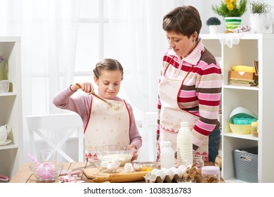 Mother and daughter cook at home. make the dough for buns