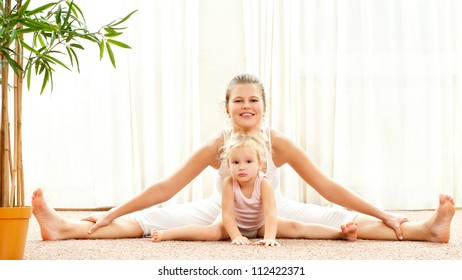 Mother and daughter doing exercise home