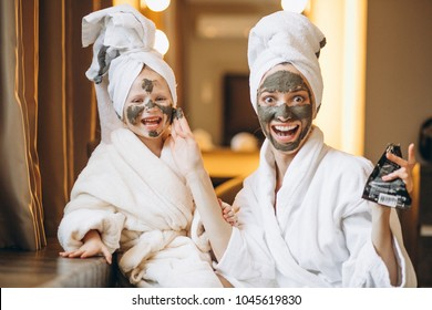 Mother and daughter doing masks