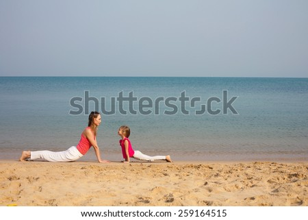 Mother and daughter doing yoga exercise