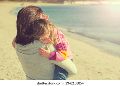 Mother and daughter embrace