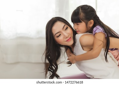 Mother and daughter embracing in the morning at home. Daughter and Mom concept.