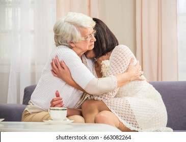 Mother and daughter in emotional scene indoor shot