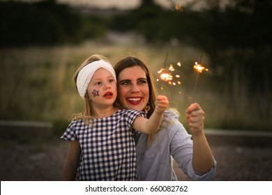 Mother and daughter enjoy Fourth of July sparklers together