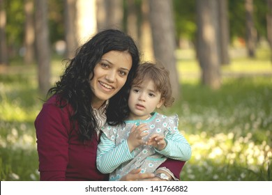Mother and daughter enjoying the spring park
