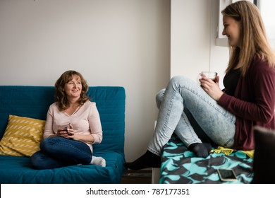 Mother and daughter enjoying tea in the living room