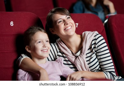 Mother with daughter enjoying time in the movie
