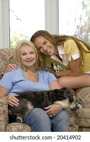 mother and daughter enjoying time with their dogs