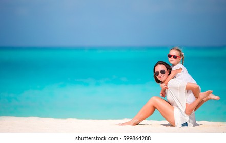 Mother and daughter enjoying time together at tropical beach