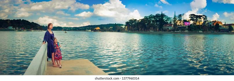 Mother and daughter enjoying at Xuan Huong Lake, Dalat, Vietnam. Panorama