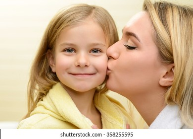Mother and daughter expressing love