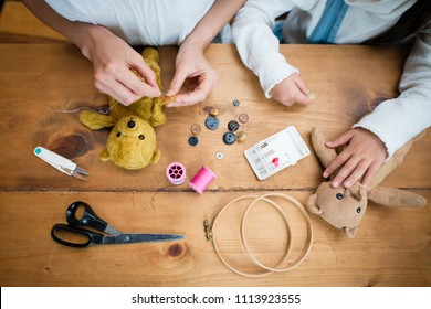 Mother and daughter fixing sewing wrappers