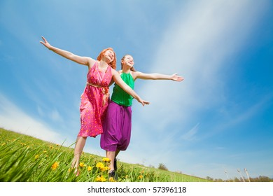 Mother and daughter with flower