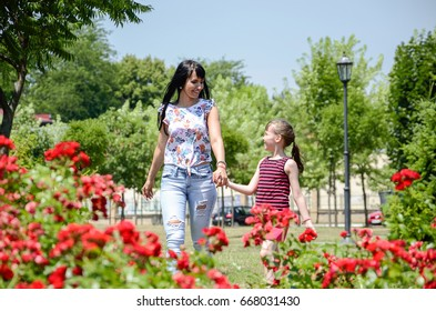 Mother and daughter in the flower garden